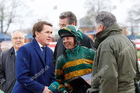 Bryony Frost with Sir Tony McCoy and Paul Nicholls after Kapcorse had won the Sir Peter O'Sullevan Memorial Handicap Chase at Newbury for absent owner JP McManus.