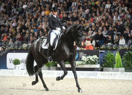 Dorothee Schneider of Germany rides her horse Sammy Davis Jr to place second at  the Grand Prix dressage event SAAB top 10 at Friends Arena in Solna, Sweden, on December 01, 2018.