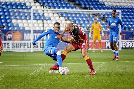 Stock Photo of Peterborough United midfielder Siriki Dembele (10) and Bradford City forward Karl Henry (48) during  the The FA Cup 2nd round match between Peterborough United and Bradford City at London Road, Peterborough