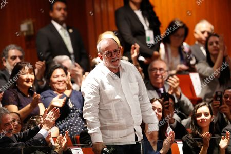 Cuban singer Silvio Rodriguez stands as he is acknowledged as the ambassador of poetry by Andres Manuel Lopez Obrador during Mexico's presidential inauguration at the National Congress, in Mexico City, . Lopez Obrador has been sworn in as Mexico's first leftist president in more than seven decades, marking a turning point in one of the world's most extreme experiments in market opening and privatization