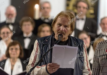 Frank Zander reads a story during an event to collect donations for homeless people in the Saint Thomas Church in Berlin, Germany, 01 December 2018. Under the topic 'open up the door' the organizer created the 'concert for people without an apartment'.