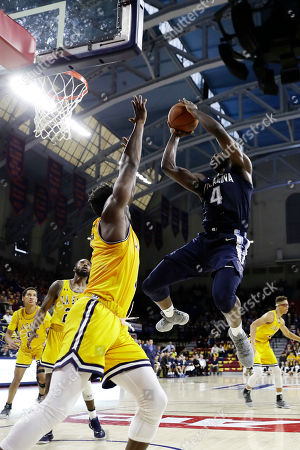 David Beatty, Eric Paschall. Villanova's Eric Paschall, right, goes up for a shot against La Salle's David Beatty during the first half of an NCAA college basketball game, in Philadelphia