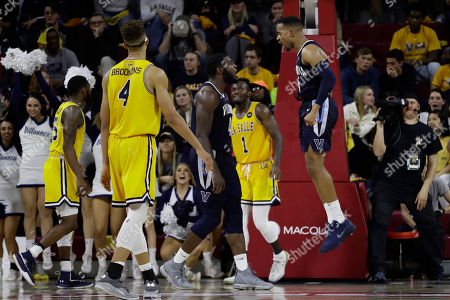 Stock Picture of Eric Paschall, Phil Booth. Villanova's Phil Booth, right, and Eric Paschall, center, celebrate after a dunk by Booth during the second half of an NCAA college basketball game against La Salle, in Philadelphia. Villanova won 85-78