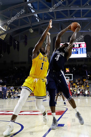Stock Image of Eric Paschall, David Beatty. Villanova's Eric Paschall (4) looks to shoot against La Salle's David Beatty (1) during the first half of an NCAA college basketball game, in Philadelphia
