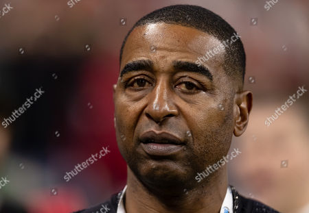 st, Fox Sports host Cris Carter walks the sidelines before the 2018 Big Ten Championship game between the Northwestern Wildcats and the Ohio State Buckeyes on at Lucas Oil Stadium in Indianapolis, IN