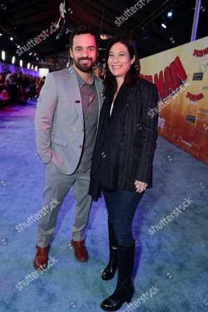 Stock Picture of Jake Johnson and Erin Payne during the Red Carpet Premiere of Columbia Pictures and Sony Pictures Animation's SPIDER-MAN: INTO THE SPIDER-VERSE at Regency Village Theatre.