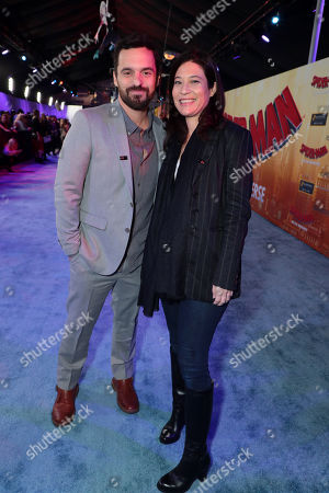 Jake Johnson and Erin Payne during the Red Carpet Premiere of Columbia Pictures and Sony Pictures Animation's SPIDER-MAN: INTO THE SPIDER-VERSE at Regency Village Theatre.