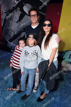 Stock Photo of Arlo Clapp, Rocko Akira Clapp, Johnny Knoxville and Naomi Nelson during the Red Carpet Premiere of Columbia Pictures and Sony Pictures Animation's SPIDER-MAN: INTO THE SPIDER-VERSE at Regency Village Theatre.
