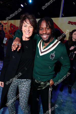 Kristine Belson, President of Sony Pictures Animation, and Shameik Moore during the Red Carpet Premiere of Columbia Pictures and Sony Pictures Animation's SPIDER-MAN: INTO THE SPIDER-VERSE at Regency Village Theatre.