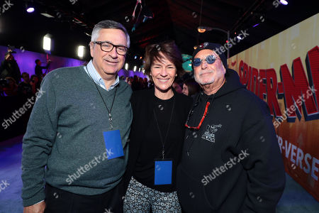 Tony Vinciquerra, Chairman and Chief Executive Officer, Sony Pictures Entertainment, Kristine Belson, President of Sony Pictures Animation, and Avi Arad, Producer, during the Red Carpet Premiere of Columbia Pictures and Sony Pictures Animation's SPIDER-MAN: INTO THE SPIDER-VERSE at Regency Village Theatre.