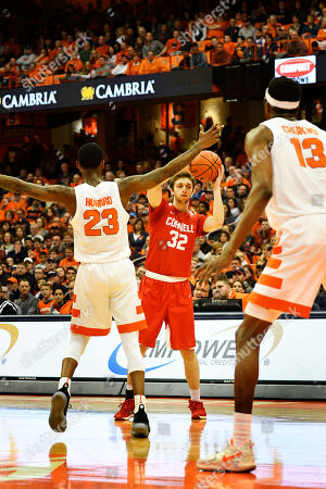 Cornell guard Jack Gordon looks to pass the ball during the second half of play. The Syracuse Orange defeated the Cornell Big Red 63-55 at the Carrier Dome in Syracuse, NY