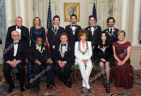 "Front row from left, David M. Rubenstein, 2018 Kennedy Center Honorees Wayne Shorter, Philip Glass, Reba McEntire, Cher, Kennedy Center President Deborah Rutter; back row from left, Deputy Secretary of State John Sullivan, Grace Rodriguez, and the 2018 Kennedy Center Honorees, the co-creators of ""Hamilton,"" Thomas Kail, Lin-Manuel Miranda, Andy Blankenbuehler, and Alex Lacamoire pose for the group photo at the State Department following the Kennedy Center Honors State Department Dinner, in Washington"