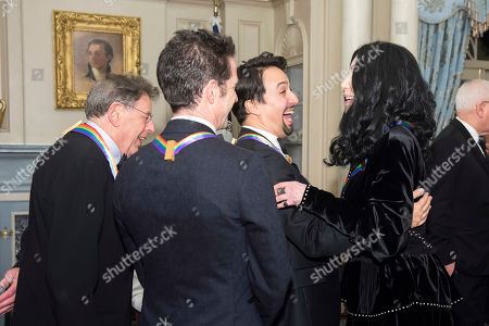 """Cher, Lin-Manuel Miranda. Cher, 2018 Kennedy Center Honoree, right, celebrates with fellow Honorees Philip Glass, left, the co-creators of """"Hamilton,"""" Andy Blankenbuehler, back to camera, and Lin-Manuel Miranda, second from right, following the Kennedy Center Honors State Department Dinner, in Washington"""