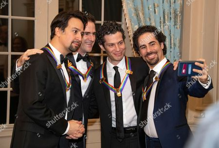 Hamilton co-creators Lin-Manuel Miranda, Andy Blankenbuehler, Thomas Kail, and Alex Lacamoire, four of the recipients of the 41st Annual Kennedy Center Honors, pose for a selfie prior to sitting for a group photo following a dinner