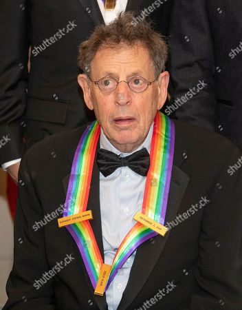 Philip Glass, one of the recipients of the 41st Annual Kennedy Center Honors, as he poses for a group photo following a dinner