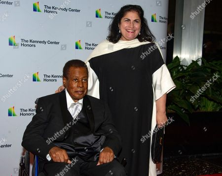 Wayne Shorter and his wife Carolina dos Santos Shorter, arrive for the formal Artist's Dinner honoring the recipients of the 41st Annual Kennedy Center Honors