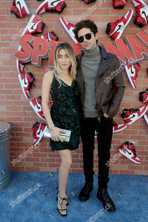 "Lexi Kaplan and Max Ehrich during the Red Carpet Premiere of Columbia Pictures and Sony Pictures Animation's ""Spider-Man: Into the Spider-Verse"" at Regency Village Theatre, in Los Angeles"