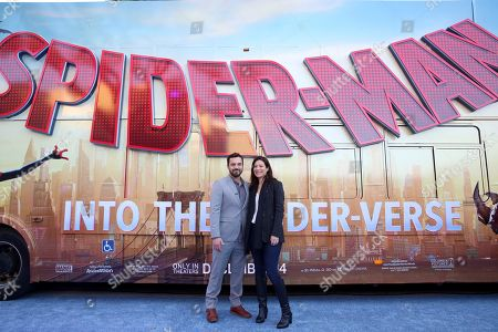 """Stock Image of Jake Johnson, Erin Payne. Jake Johnson and Erin Payne during the Red Carpet Premiere of Columbia Pictures and Sony Pictures Animation's """"Spider-Man: Into the Spider-Verse"""" at Regency Village Theatre, in Los Angeles"""