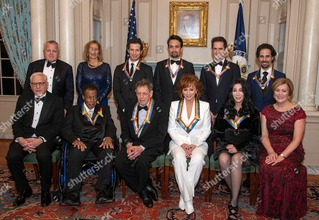 Recipients of the 41st Annual Kennedy Center Honors pose for a group photo at the US Department of State in Washington, DC, USA, 01 December 2018. The 2018 honorees are: singer and Cher ; composer and pianist Philip Glass ; Country music entertainer Reba McEntire ; and jazz saxophonist and composer Wayne Shorter. This year, the co-creators of Hamilton: An American Musical writer and actor Lin-Manuel Miranda, director Thomas Kail, choreographer Andy Blankenbuehler, and music director Alex Lacamoire will receive a unique Kennedy Center Honors as trailblazing creators of a transformative work that defies category.