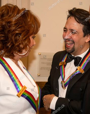 Reba McEntire (L) and Lin-Manuel Miranda (R), two of the recipients of the 41st Annual Kennedy Center Honors, converse prior to posing for a group photo at the US Department of State in Washington, DC, USA, 01 December 2018. The 2018 honorees are: singer and Cher ; composer and pianist Philip Glass ; Country music entertainer Reba McEntire ; and jazz saxophonist and composer Wayne Shorter. This year, the co-creators of Hamilton: An American Musical writer and actor Lin-Manuel Miranda, director Thomas Kail, choreographer Andy Blankenbuehler, and music director Alex Lacamoire will receive a unique Kennedy Center Honors as trailblazing creators of a transformative work that defies category.