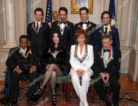 The recipients of the 41st Annual Kennedy Center Honors; (L-R back row) Thomas Kail, Lin-Manuel Miranda, Andy Blankenbuehler, and Alex Lacamoire ; (L-R, front row), Wayne Shorter, Cher, Reba McEntire, and Philip Glass, pose for a group photo following a dinner hosted by United States Deputy Secretary of State John J. Sullivan in their honor at the US Department of State in Washington, DC, USA, 01 December 2018. The 2018 honorees are: singer and Cher ; composer and pianist Philip Glass ; Country music entertainer Reba McEntire ; and jazz saxophonist and composer Wayne Shorter. This year, the co-creators of Hamilton: An American Musical writer and actor Lin-Manuel Miranda, director Thomas Kail, choreographer Andy Blankenbuehler, and music director Alex Lacamoire will receive a unique Kennedy Center Honors as trailblazing creators of a transformative work that defies category.