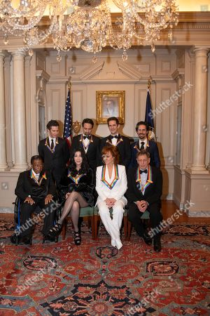 Stock Image of The recipients of the 41st Annual Kennedy Center Honors; (L-R back row) Thomas Kail, Lin-Manuel Miranda, Andy Blankenbuehler, and Alex Lacamoire ; (L-R, front row), Wayne Shorter, Cher, Reba McEntire, and Philip Glass, pose for a group photo following a dinner hosted by United States Deputy Secretary of State John J. Sullivan in their honor at the US Department of State in Washington, DC, USA, 01 December 2018. The 2018 honorees are: singer and Cher ; composer and pianist Philip Glass ; Country music entertainer Reba McEntire ; and jazz saxophonist and composer Wayne Shorter. This year, the co-creators of Hamilton: An American Musical writer and actor Lin-Manuel Miranda, director Thomas Kail, choreographer Andy Blankenbuehler, and music director Alex Lacamoire will receive a unique Kennedy Center Honors as trailblazing creators of a transformative work that defies category.