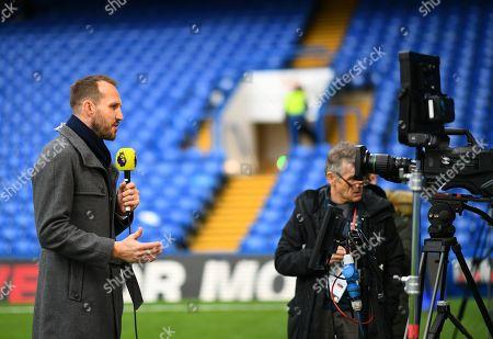 Former Fulham and Chelsea goalkeeper Mark Schwarzer working for television