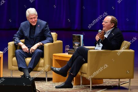 Stock Image of President Bill Clinton and author James Patterson during a discussion of their new book 'The President is Missing'