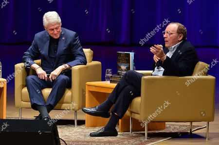 President Bill Clinton and author James Patterson speak on stage during a discussion of their new book 'The President Is Missing'