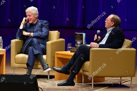 Editorial photo of Bill Clinton and James Patterson book promotion, Miami, USA - 01 Dec 2018