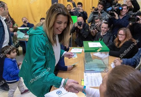 Ruling PSOE party's candidate for the Andalusian Presidency, Susana Diaz (C), greets a member of polling station as she votes during the Andalusian regional election, in Seville, Spain, 02 December 2018. More than six million of people are called to elect the 109 seats of the 11th Parliament of the Autonomous Community of Andalusia after the previous Parliament was dissolved as a result of Ciudadanos party's withdrawal of support to ruling PSOE party forcing the Regional President Susana Diaz's Government to call snap election for 02 December.