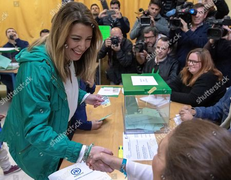 Ruling PSOE party's candidate for the Andalusian Presidency, Susana Diaz (L), greets a member of polling station as she votes during the Andalusian regional election, in Seville, Spain, 02 December 2018. More than six million of people are called to elect the 109 seats of the 11th Parliament of the Autonomous Community of Andalusia after the previous Parliament was dissolved as a result of Ciudadanos party's withdrawal of support to ruling PSOE party forcing the Regional President Susana Diaz's Government to call snap election for 02 December.