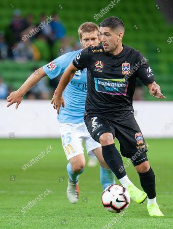 Newcastle Jets forward Dimitri Petratos (7) runs the ball down field at the Hyundai A-League Round 6 soccer match