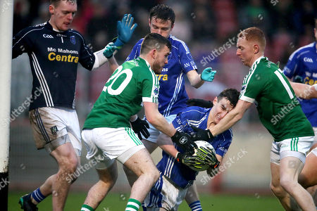 Gweedore vs Scotstown. Scotstown's Jack McDevitt and Kevin McMeel with James Carroll of Gweedore