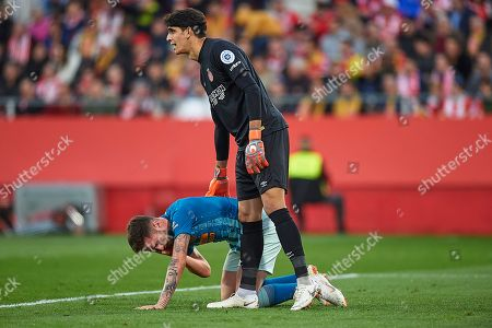 Saúl Niguez of Atletico de Madrid injured on the floor and Yassine Bounou of Girona FC