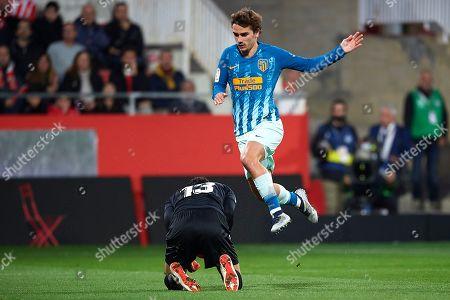 Antoine Griezmann of Atletico de Madrid jumps on Yassine Bounou of Girona FC