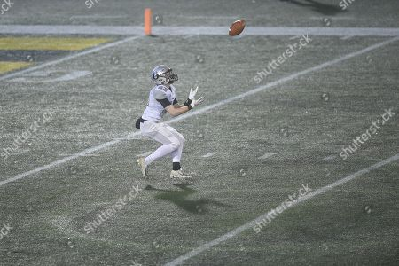 Oakdale's Noah Miller (23) catches a deep pass during the Maryland State 2A football championship at the Navy-Marine Corps Memorial Stadium in Annapolis, MD. The Oakdale boys took their first ever state championship after defeating Glenelg 35-7
