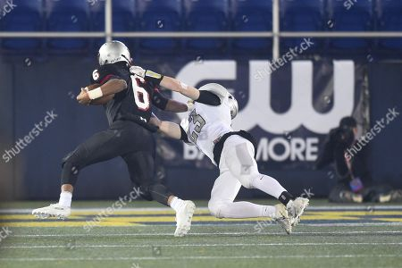 Oakdale's S Noah Miller (23) tries to tackle Glenelg's RB Wande Owens (6) rushes with the ball during the Maryland State 2A football championship at the Navy-Marine Corps Memorial Stadium in Annapolis, MD. The Oakdale boys took their first ever state championship after defeating Glenelg 35-7