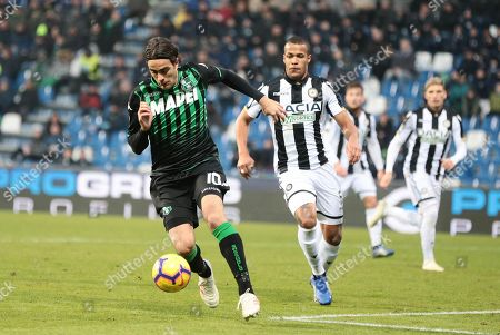 Sassuolo's Alessandro Matri (L) and Udinese's William Ekong (R) in action during the Italian Serie A soccer match between US Sassuolo and Udinese Calcio at Mapei Stadium in Reggio Emilia, Italy, 02 December 2018.