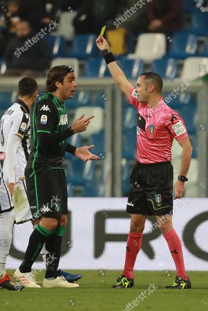 Referee Marco Guida (R) shows the yellow card to Alessandro Matri during the Italian Serie A soccer match between US Sassuolo and Udinese Calcio at Mapei Stadium in Reggio Emilia, Italy, 02 December 2018.