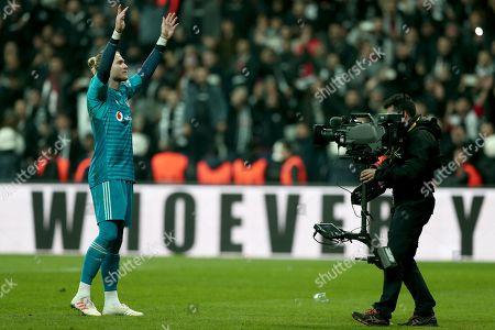 Besiktas' goalkeeper Loris Karius (L) celebrates  winning the Turkish Super League derby match between Besiktas and Galatasaray in Istanbul, Turkey, 02 December 2018.