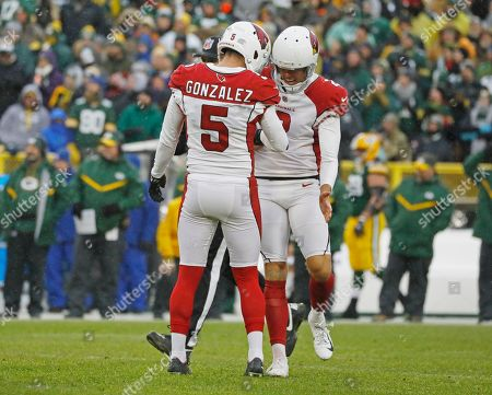 Arizona Cardinals kicker Zane Gonzalez and punter Andy Lee (2) celebrate the go ahead field goal late in the second half of an NFL football game, in Green Bay, Wis. Arizona won 20-17