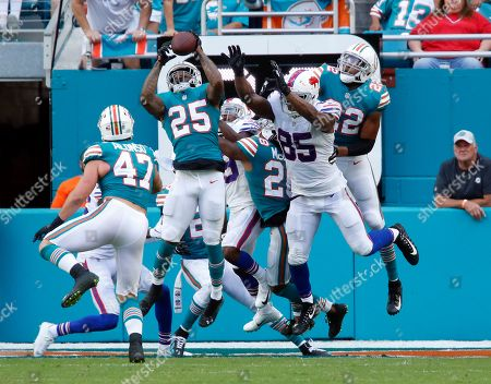 Stock Picture of Xavien Howard, Charles Clay. Miami Dolphins cornerback Xavien Howard (25) intercepts a long pass in the enzone intended for Buffalo Bills tight end Charles Clay (85), during the first half of an NFL football game, in Miami Gardens, Fla