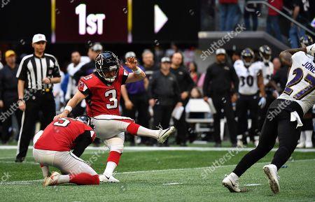 Atlanta Falcons kicker Matt Bryant (3) kicks a field goal against the Baltimore Ravens during the first half of an NFL football game, in Atlanta