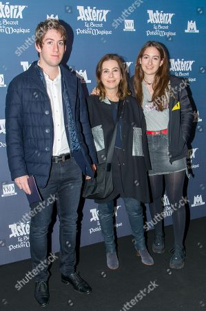 Anne Goscinny (C) poses with son Simon and daughter Salome
