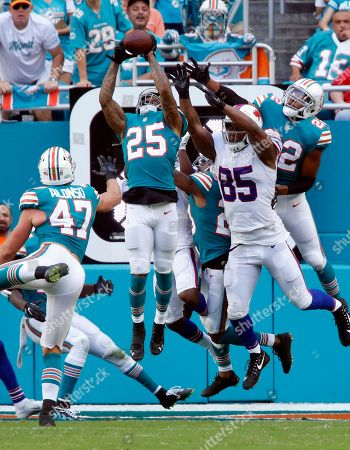Stock Photo of Xavien Howard, Charles Clay. Miami Dolphins cornerback Xavien Howard (25) intercepts a long pass in the enzone intended for Buffalo Bills tight end Charles Clay (85), during the first half of an NFL football game, in Miami Gardens, Fla