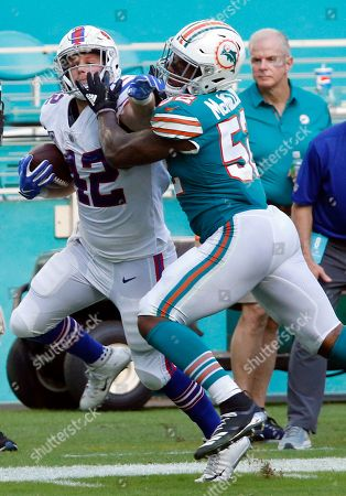 Raekwon McMillan, Patrick DiMarco. Miami Dolphins middle linebacker Raekwon McMillan (52) grabs Buffalo Bills running back Patrick DiMarco (42), during the second half of an NFL football game, in Miami Gardens, Fla