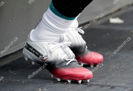 Jacksonville Jaguars fullback Tommy Bohanon wears cleats supporting his cause at an NFL football game against the Indianapolis Colts, in Jacksonville, Fla