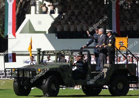 Mexican President Andres Manuel Lopez Obrador (C) reviews the armed forces accompanied by the Secretary of National Defense, General Luis Cresentcio Sandoval (L), and the Secretary of the Navy, Admiral Jose Rafael Ojeda Duran (R), at Campo Marte, in Mexico City, Mexico, 02 December 2018. Obrador was sworn into office the previous day.
