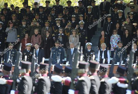 The president of Mexico, Andres Manuel Lopez Obrador (C), accompanied by the Secretary of National Defense, General Luis Cresentcio Sandoval (C-L), and the Secretary of the Navy, Admiral Jose Rafael Ojeda Duran (C-R), watches a parade of the armed forces at Campo Marte, in Mexico City, Mexico, 02 December 2018. Obrador was sworn into office the previous day.